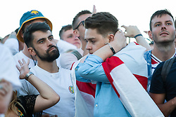 © Licensed to London News Pictures. 28/06/2018. Brighton, UK. England supporters watch the 2018 England vs Game game on the La Luna big screen on the beach in Brighton. England lost 1-0 to Belgium. Photo credit: Hugo Michiels/LNP
