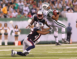 Sept 19, 2011; East Rutherford, NJ, USA; New York Jets tight end Dustin Keller (81) catches a pass while New England Patriots safety Pat Chung (25) tries to tackle him during the 2nd half at the New Meadowlands Stadium.  The Jets defeated the Patriots 28-14.