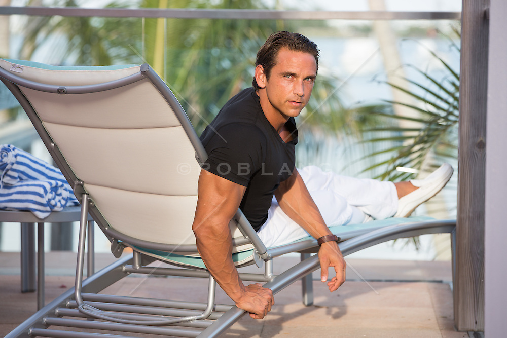 handsome man in a lounge chair looking at camera
