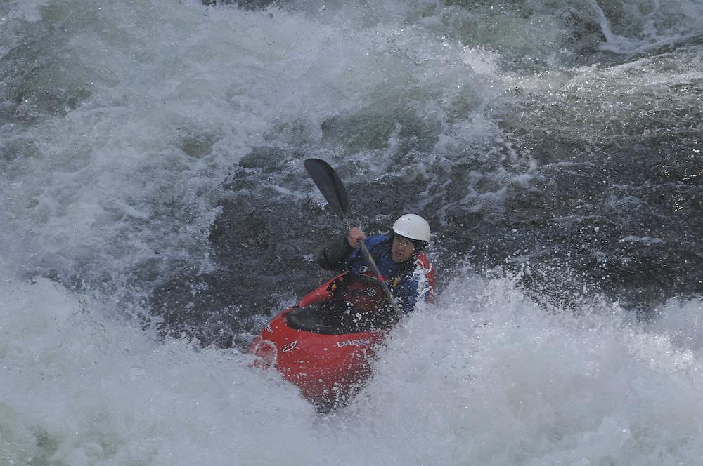 White water kayakers brave class IV rapids like Thunderhole and 10-foot Falls at Wilson Creek river near  Morganton, NC.