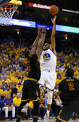 The Golden State Warriors' Andre Iguodala (9) takes a shot against Cleveland Cavaliers' Tristan Thompson (13) in the second quarter of Game 5 of the NBA Finals at Oracle Arena in Oakland, Calif., on Monday, June 12, 2017. (Photo by Nhat V. Meyer/Bay Area News Group/TNS) *** Please Use Credit from Credit Field ***