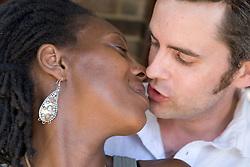 Portrait of a couple kissing,