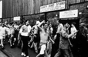 Football hooligans at Mansfield Park, Notts County, U.K, 1990.