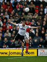 Morten Bisgaard of Derby County (white) loses an aeriel challange against a Wrexham defender