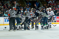KELOWNA, CANADA - APRIL 22: Referees Brett Iverson and Fraser Lawrence call penalties against players of the Kelowna Rockets and Seattle Thunderbirds on April 22, 2016 at Prospera Place in Kelowna, British Columbia, Canada.  (Photo by Marissa Baecker/Shoot the Breeze)  *** Local Caption *** Brett Iverson; Fraser Lawrence; Referee;