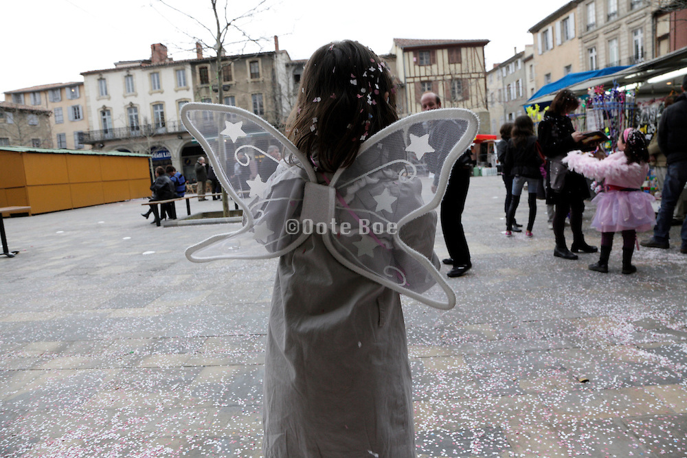 child with angel wings during Carnaval France Limoux