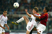 Roma 20 Maggio 2003 - Rome May 20 2003 <br />Andata finale di Coppa Italia - First Match final Italy's Cup <br />Roma Milan 1-4 <br /><br />John Dahl Tomasson (Milan) challenged by Jonathan Zebina (Roma)