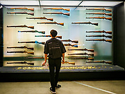 08 JUNE 2018 - SEOUL, SOUTH KOREA: A teenager looks at a display of M1 Garand rifles at the War Memorial of Korea in Seoul, South Korea. The M1 was carried by US soldiers in the Korean War and was the South Korean service rifle for many years. With the near constant threat of invasion from North Korea, many South Koreans take great pride in the ability of their armed forces. Some observers believe there is a possibility that a peace agreement between South and North Korea could be signed following the Trump/Kim summit in Singapore. The War Memorial and museum opened in 1994 on the former site of the army headquarters to exhibit and memorialize the military history of Korea. When it opened in 1994 it was the largest building of its kind in the world. The museum features displays about the Korean War and many static displays of military equipment.    PHOTO BY JACK KURTZ