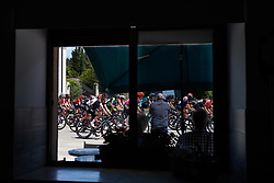 The peloton speed by a bar during Stage 10 of 2019 Giro Rosa Iccrea, a 120 km road race from San Vito al Tagliamento to Udine, Italy on July 14, 2019. Photo by Sean Robinson/velofocus.com