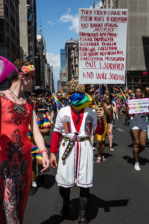 New York, NY - 30 June 2019. The New York City Heritage of Pride March filled Fifth Avenue for hours with participants from the LGBTQ community and it's supporters. A man protests the treatment of the LGBTQ cmmunity by Russia and its allies.