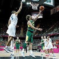 02 August 2012: Lithuania Simas Jasaitis goes for the reverse layup past Nicolas Batum of France during 82-74 Team France victory over Team Lithuania, during the men's basketball preliminary, at the Basketball Arena, in London, Great Britain.