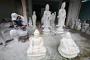Marble Mountains. Working on  a marble Buddha sculpture.