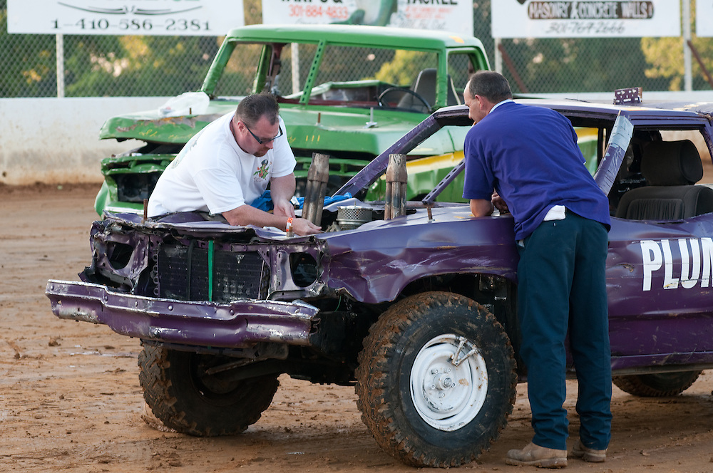 Men working on vehicle for a demolition derby