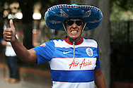 a QPR fan wearing a sombrero &amp; Ray Bans while posing outside Loftus Road before k/o. Skybet EFL championship match, Queens Park Rangers v Leeds United at Loftus Road Stadium in London on Sunday 7th August 2016.<br /> pic by John Patrick Fletcher, Andrew Orchard sports photography.