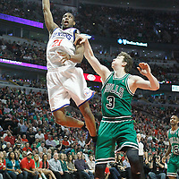 17 March 2012: Philadelphia Sixers forward Thaddeus Young (21) dunks the ball on Chicago Bulls center Omer Asik (3) during the Chicago Bulls 89-80 victory over the Philadelphia Sixers at the United Center, Chicago, Illinois, USA.