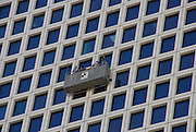 Israel, Tel Aviv Azrieli shopping business centre buildings, October 2006, window cleaners platform