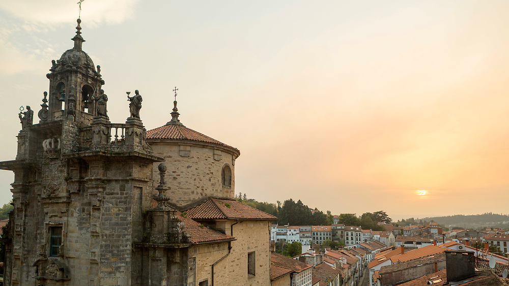 Church architecture and sunset over the city of Santiago de Compostela, Galicia, Spain.