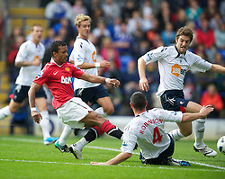 BOLTON, ENGLAND - Sunday, September 26, 2010: Manchester United's Nani scores the equalising goal against Bolton Wanderers during the Premiership match at the Reebok Stadium. (Photo by David Rawcliffe/Propaganda)