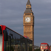 London Bus traffic crossing Westminster Bridge with Big Ben, the north tower of the British Houses of Parliament, London, England, UK in background<br />