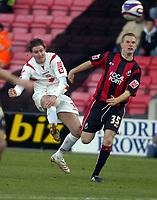 Photo: Matt Bright/Sportsbeat Images.<br /> AFC Bournemouth v Swindon Town. Coca Cola League 1. 29/12/2007.<br /> Barry Corr of Swindon scores past Alex Pearce of Bournemouth