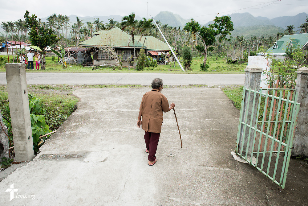 98 year-old Angel Tugonon leaves Christ Lutheran Church in Mayahag, Leyte Province, Philippines, on Sunday, March 16, 2014. Angel lost his home during Typhoon Haiyan. Church members found out about his plight and rebuilt his house. Shortly afterward, Tugonon started attending services. LCMS Communications/Erik M. Lunsford