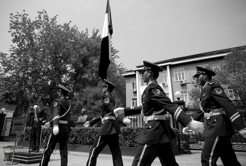 Paramilitary police walk outside of the Mexican embassy in China..May 5, 2009. Photo: Bernardo De Niz.  Mexico announced plans on Monday to send a plane to retrieve dozens of its nationals confined across China, which quarantined them as a protective measure against a deadly new strain of flu..