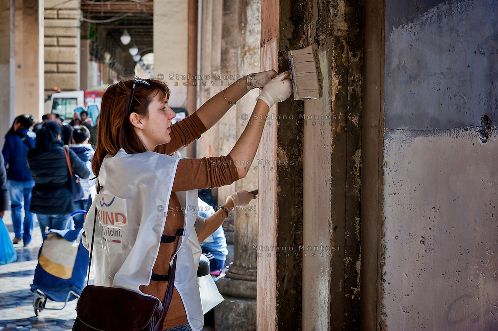 "Volunteers clean the Piazza Vittorio.<br /> ""Wake up Roma ', the great collective mobilization promoted by Retake and Luiss EnLabs for the decorum of the city against the deterioration and abandonment. About three thousand volunteers with scrapers and brushes in hand they removed posters and stickers, clean walls and poles, they cleaned up gardens and flower beds, driveways and sidewalks. Interventions to Piazza Vittorio, Porta Maggiore, Villa Paganini and place Anco Marzio in Ostia. Rome, Italy 12th March 2016"