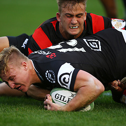 DURBAN, SOUTH AFRICA, 12 August, 2016 -Jeremy Ward (C) of the EP Kings 21's looks to tackle Tristan Blewett of the Cell C Sharks Under 21's as he is over for a try  during the match between The Cell C Sharks U21 and EP U21 Currie Cup Under 19 Competition at Growthpoint Kings Park in Durban, South Africa. (Photo by Steve Haag)<br /> <br /> images for social media must have consent from Steve Haag