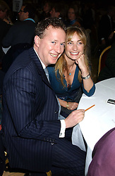 ORLANDO FRASER and CLEMENTINE HAMBRO at a quiz night in aid of RAPt ( The Rehabilitation for Addicted Prisoners Trust) held at Hammersmith Town Hall, King Street, London W6 on 14th November 2005.<br />