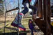 The pack of Deeds' children all jumped at the chance to finally play outside as soon as the weather began to warm up in March. Amelia climbs up ad down the ropes and ladders while her younger sister Ju Ju runs through the mud.