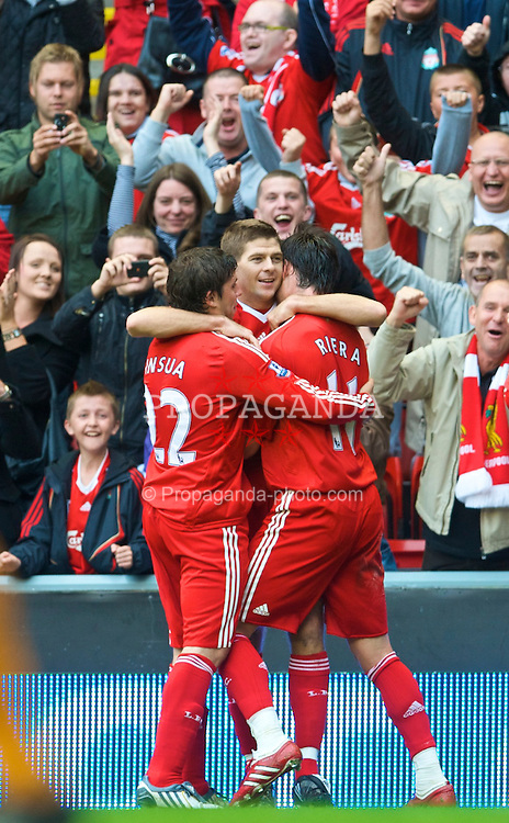 LIVERPOOL, ENGLAND - Saturday, September 26, 2009: Liverpool's captain Steven Gerrard MBE celebrates scoring a world class goal for his side, their fourth against Hull City during the Premiership match at Anfield. (Photo by: David Rawcliffe/Propaganda)