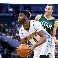 20 November 2016: Denver Nuggets guard Emmanuel Mudiay (0) drives past Utah Jazz guard Dante Exum (11) during the Denver Nuggets 105-91 victory over the Utah Jazz, at the Pepsi Center, Denver, Colorado, USA.