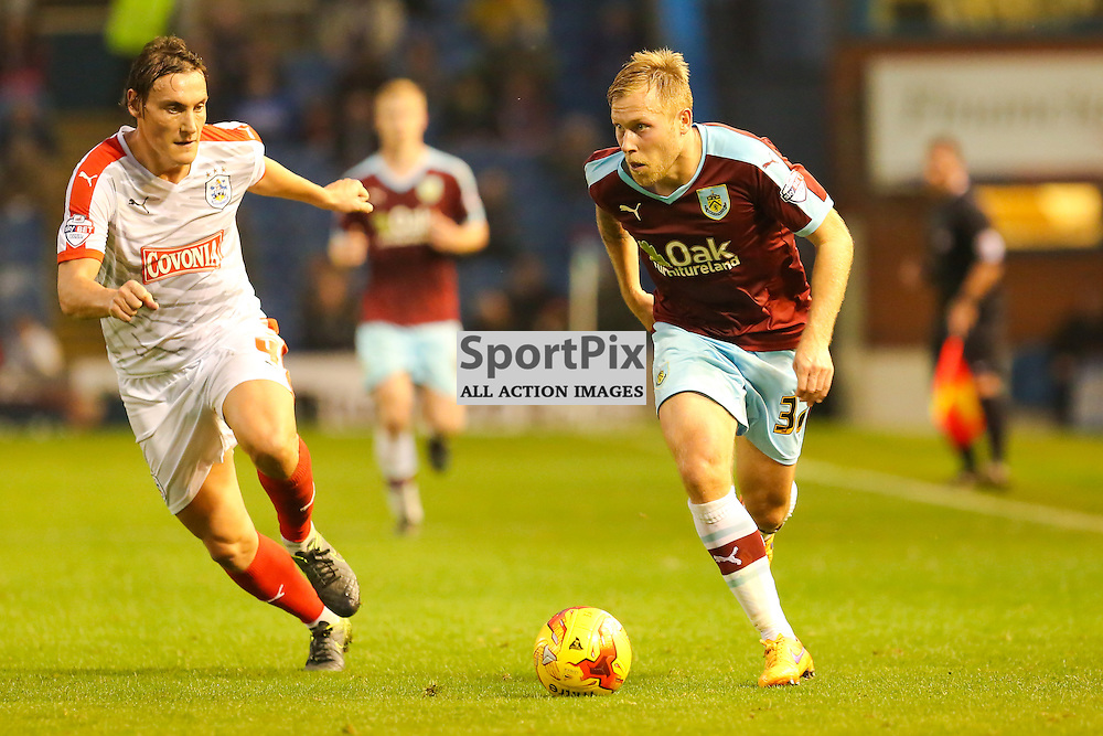 Dean Whitehead of Huddersfield Town in action with Scott Arfield of Burnley during Burnley v Huddersfield Town, Sky Bet Championship, 31 October 2015,  (c) Jackie Meredith/SportPix.org.uk