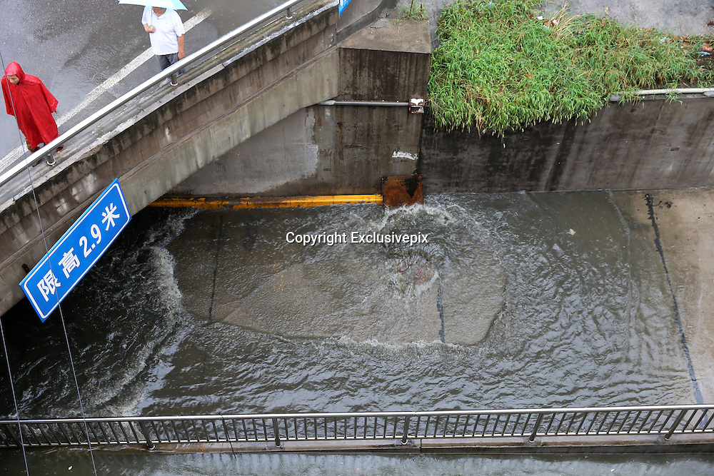 XI\'AN, CHINA - AUGUST 12: (CHINA OUT) <br /> <br /> Bus Gets Submerged In Water At Tunnel <br /> <br /> water is seen on August 12, 2014 in Xi\'an, Shaanxi province of China. Torrential rains hit Xi\'an, which caused more and more standing waters on Xi\'an, Shaanxi province of China.<br /> ©Exclusivepix