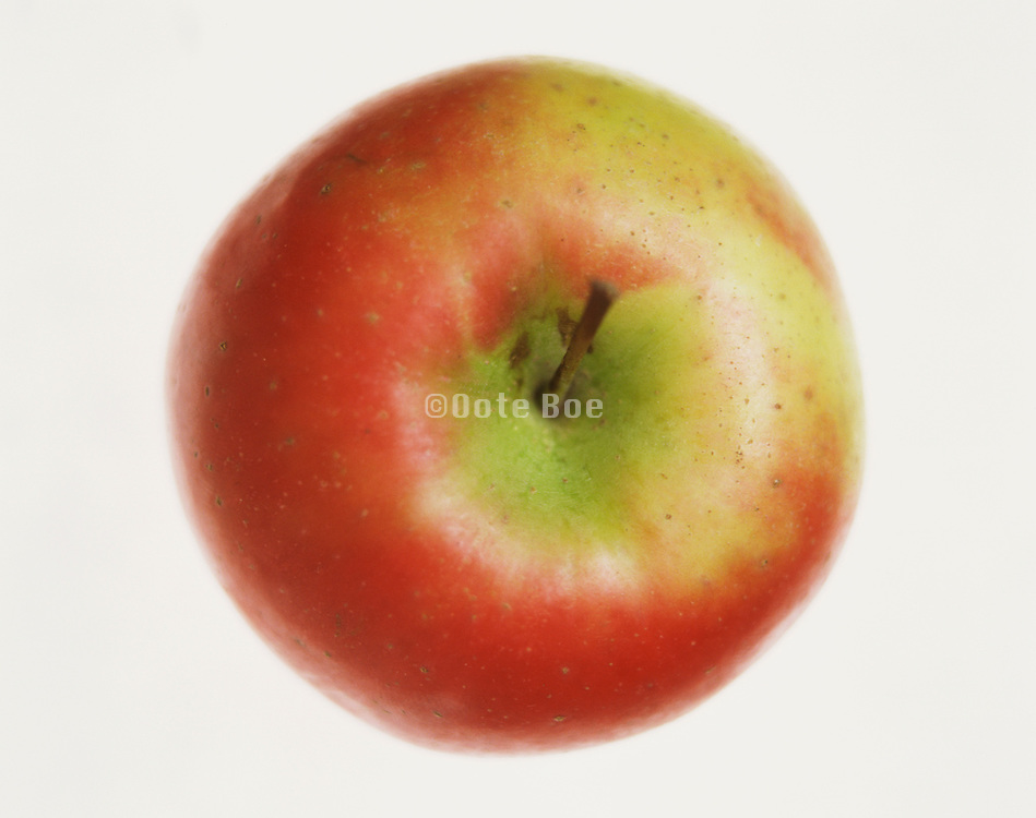 A single red apple shot from above