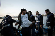 ITALY, Lampedusa :Tunisian migrants arrive in Lampedusa on March 24, 2011. Copyright Christian Minelli.