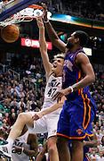 Utah Jazz forward Andrei Kirilenko (47) scores against New York Knicks forward Shawne Williams (3) during the second half of an NBA basketball game in Salt Lake City, Wednesday Jan. 12, 2011. The Jazz defeated the Knicks 131-125. (AP Photo/Colin E Braley)