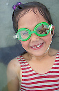 Girl with starfish on swimming goggles