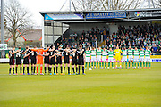 Yeovil and Carlisle players observing a minutes silence for the Brussels bombing victims before kick off of the Sky Bet League 2 match between Yeovil Town and Carlisle United at Huish Park, Yeovil, England on 25 March 2016. Photo by Graham Hunt.