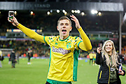 Norwich City midfielder Todd Cantwell (36)  celebrates promotion to the premier league after the EFL Sky Bet Championship match between Norwich City and Blackburn Rovers at Carrow Road, Norwich, England on 27 April 2019.