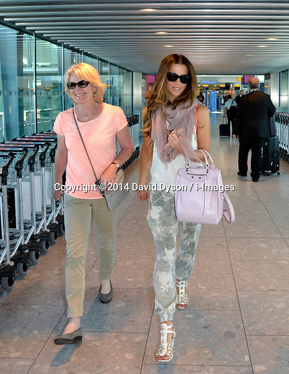 Image ©Licensed to i-Images Picture Agency. 03/07/2014. United Kingdom. Kate Beckinsale and with her mother at Heathrow. Kate was at Heathrow to see the departure of her daughter. Heathrow Airport. Picture by David Dyson / i-Images