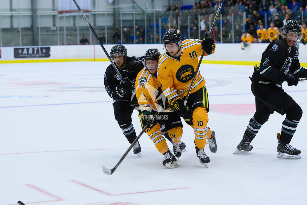 2nd year forward JJ Coleshaw (10) of the Regina Cougars  and 1st year forward Gary Marr (19) of the Regina Cougars during the Shine On game on October 28 at The Co-Operators Arena. Credit: /Arthur Images