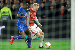 Donny van de Beek #6 of Ajax and Dakonam Djene #2 of Getafe in action during the Europa League match R32 second leg between Ajax and Getafe at Johan Cruyff Arena on February 27, 2020 in Amsterdam, Netherlands