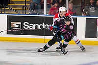 KELOWNA, BC - SEPTEMBER 21:  Jordan Chudley #5 of the Spokane Chiefs back checks Dillon Hamaliuk #22 of the Kelowna Rockets at Prospera Place on September 21, 2019 in Kelowna, Canada. (Photo by Marissa Baecker/Shoot the Breeze)