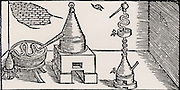 Distillation of alcohol (aqua vitae).  Distillation took place in an alembic set over a furnace.  The distillate was discharged through spout into a 'work' in a bath of cold water and was collected in the vessel at the left. From 'De la pirotechnia' by Vannoccio Biringuccio (Venice, 1540).