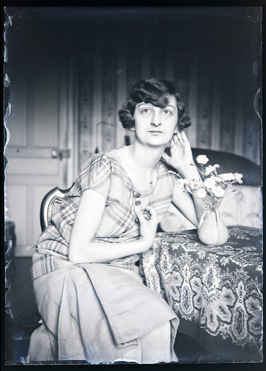 woman posing with flower in a little vase France circa 1930s