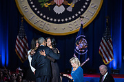 President Obama gives First Lady Michelle Obama a hug following his farewell speech at McCormick Place in Chicago on January 10, 2017.
