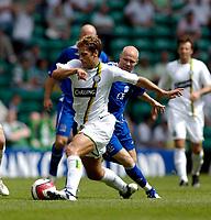 Photo: Jed Wee.<br /> Glasgow Celtic v Everton. Pre Season Friendly. 23/07/2006.<br /> <br /> Celtic's Stilian Petrov (L) beats Everton's Andy Johnson.