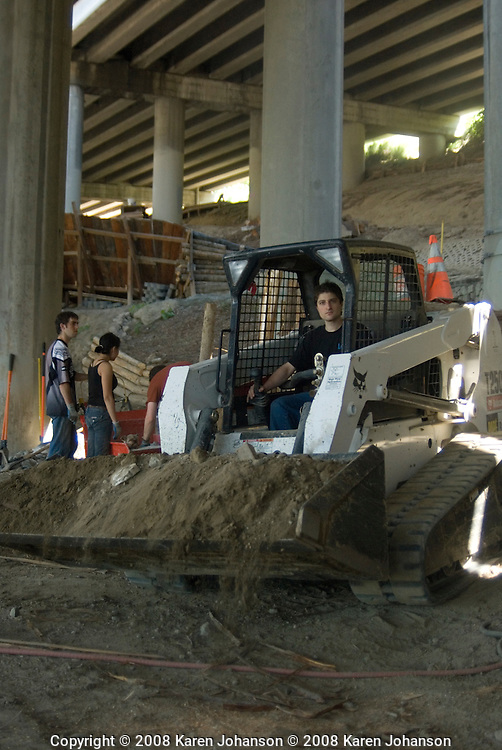 Builder Kim Sturts manning the bobcat at the Colonnade Bike Park in Seattle, WA