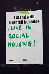 London, UK. 14th June, 2018. A poster on the route of the Grenfell Silent March through West Kensington on the first anniversary of the Grenfell Tower fire. 72 people died in the Grenfell Tower fire and over 70 were injured.